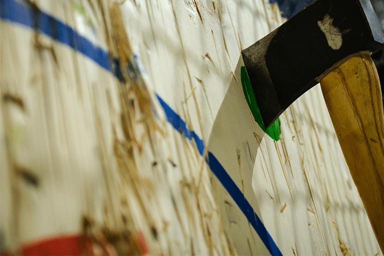 axe in wooden target